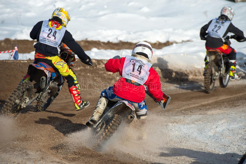 Overtaking. BORODINO, RUSSIA - FEBRUARY 5: Unidentified riders drive during at the all-Russian motocross named VP Chkalov, the organizer of the Auto-motorcycle stock photos