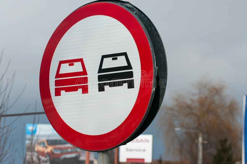 Overtaking forbidden street sign on the road. On a cloudy day stock images