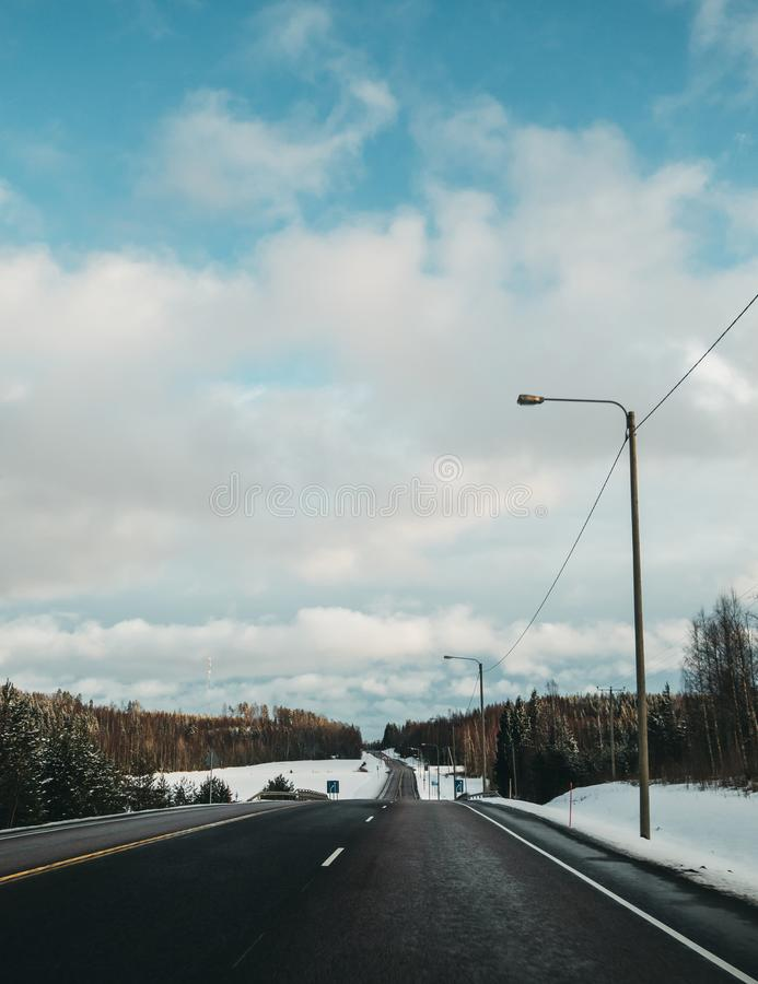 Overtaking lane on road number 2 in Finland. Winter day and an empty road with three lanes, one for overtaking royalty free stock photo