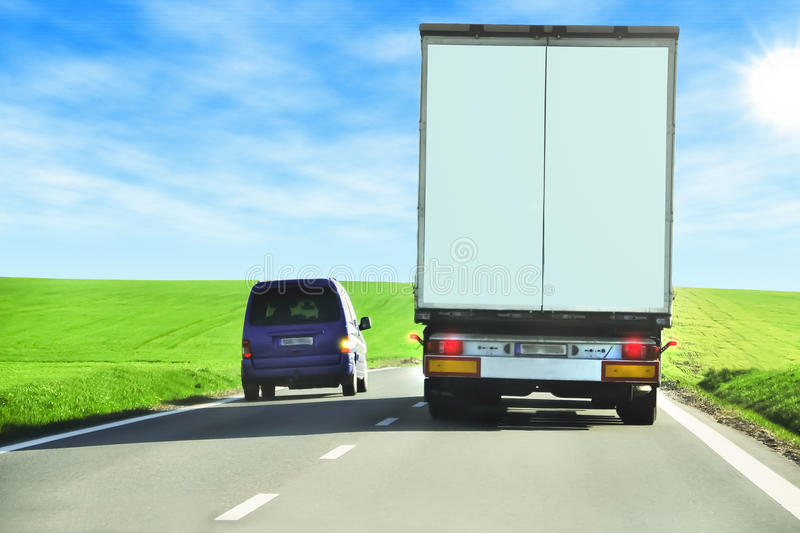 Overtaking. Personal car overtaking a truck stock photography
