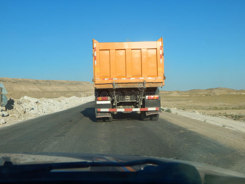 Overtaking truck. Passing truck on a narrow road. Kazakhstan, Mangistau stock images