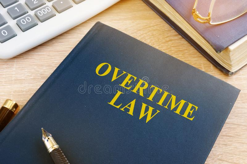 Overtime law and calculator. royalty free stock image