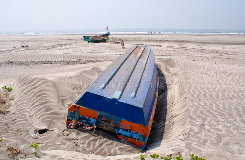 Download An Overturned Blue Coloured Boat In A Beach In Konkan Stock Photo - Image of blue, overturned: 71670056
