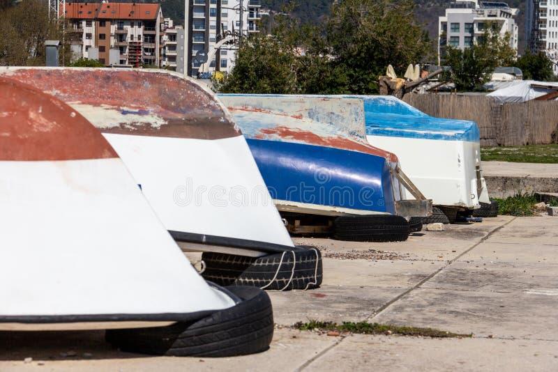 Overturned boats on a sidewalk near Old Town Budva royalty free stock photos