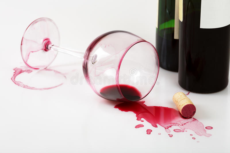 Overturned glass and wine stains stock photography