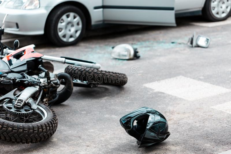 Overturned motorcycle after collision stock images