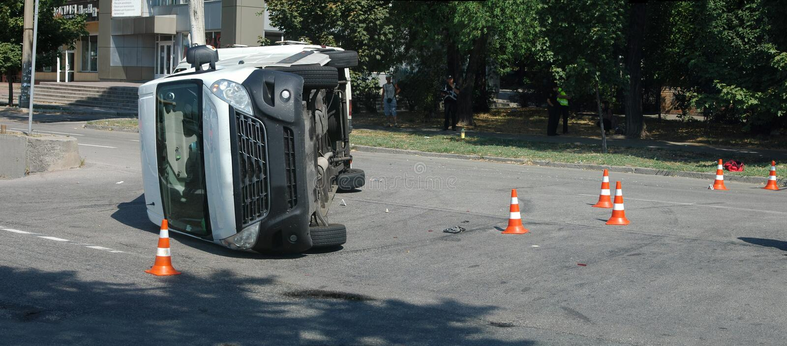Overturned transport on accident site with traffic cones royalty free stock photo