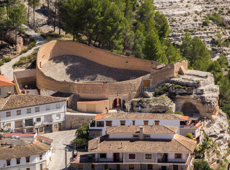 Overview of Alcala del Jucar in Castilla-La Mancha, Spain. Bullfighting arena in hilltop town of Alcala del Jucar in Castilla-La Mancha, Spain, Europe royalty free stock images