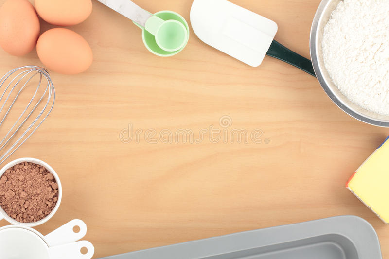 Overview Baking on Wood Bench. Overview of ingredients and utensils for baking on wooden kitchen table royalty free stock image