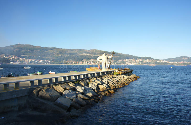 Overview of breakwaters with sculpture Moaña stock photo