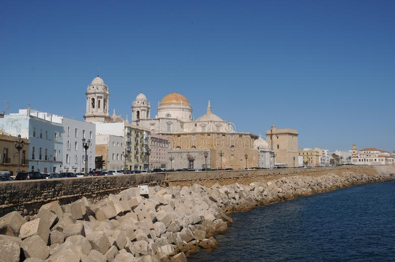 Overview of the city of Cadiz Cathedral of the Holy Cross, next to the beach and the pier Cadiz, Andalusia, Spain.  stock photography