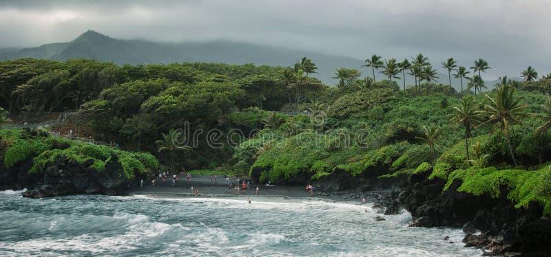 Overview of Honokalani Black Sand Beach Road to Hana, Maui stock images