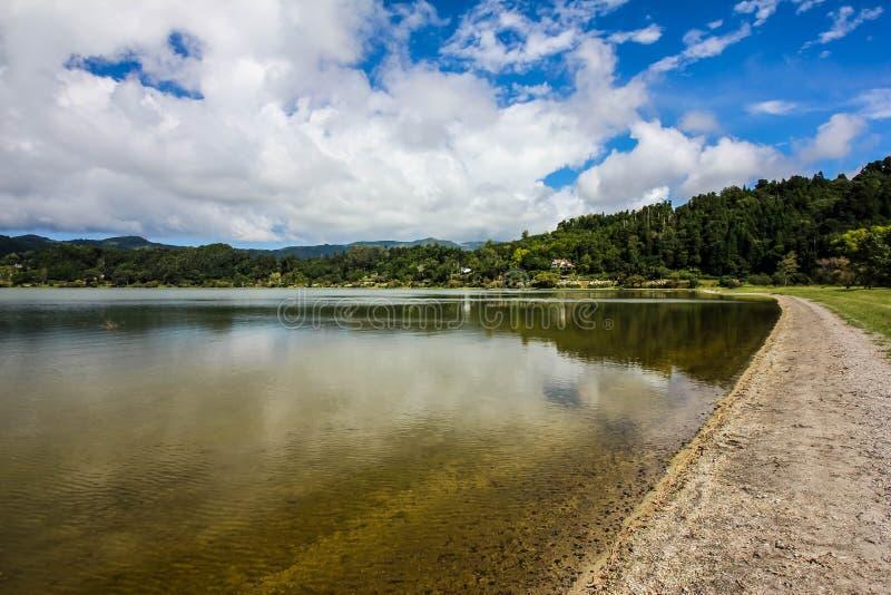 Overview lake, blue sky, clouds, trees Jose do Canto Forest Garden, Furnas, Sao Miguel, Azores Portugal. Overview of the lake near Jose do Canto Forest Garden stock photos