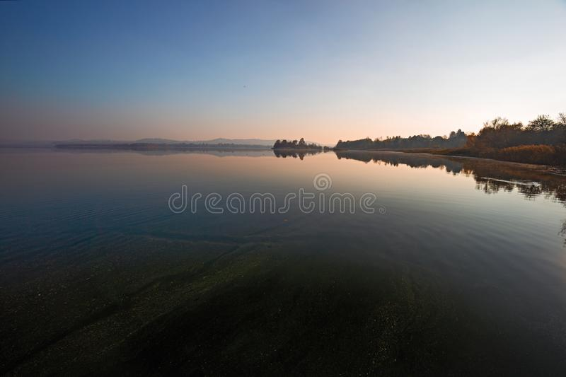 Overview of the lake at sunset stock photography
