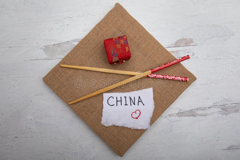Overview travel industry background chopsticks oriental gift boxwhite piece of paper with the word China hand written on sign. Overview lay flat travel industry stock photography