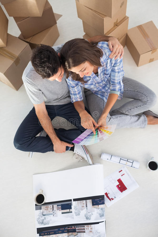 Overview of a man and his wife looking at house plans royalty free stock photos