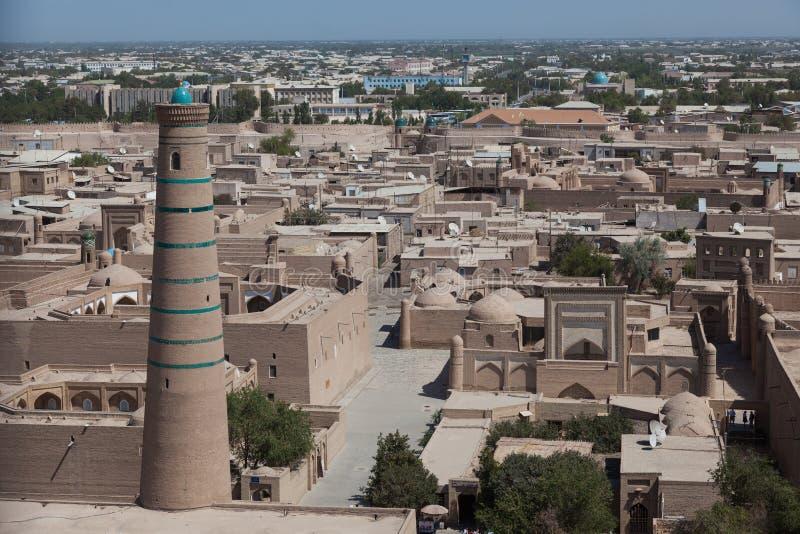 Kalta Minor minaret in Khiva, Khorezm Region, Uzbekistan. Overview of oriental buildings of old city of Itchan Kala. Khiva, Uzbekistan royalty free stock photography