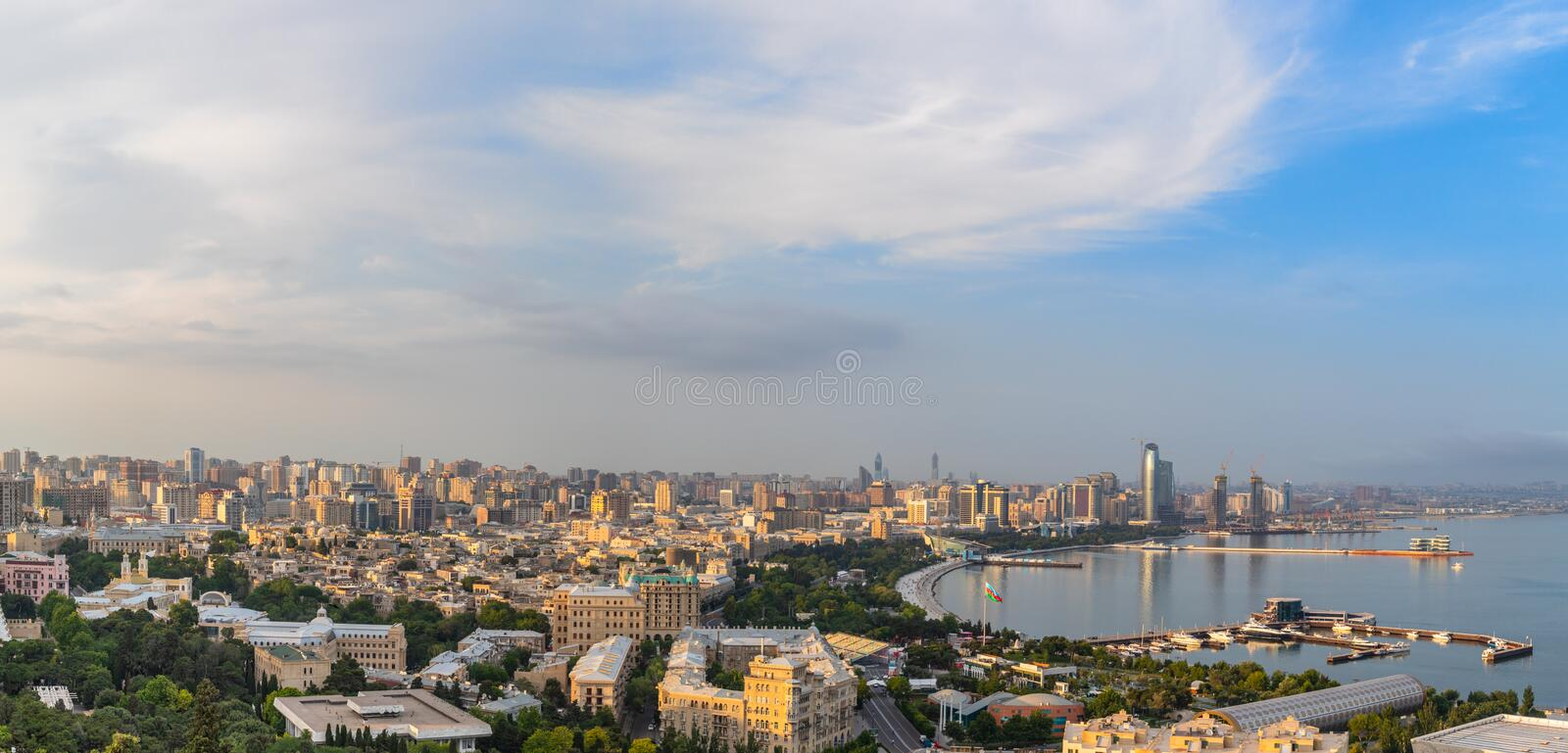 Overview panorama of central city business district at the bay with marina and residential suburbs in sunset rays, Baku, stock photos