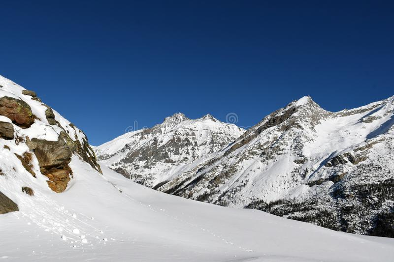 Gran Paradiso. Overview of the peaks of the Gran Paradiso, seen from the Valsavaranche royalty free stock photos
