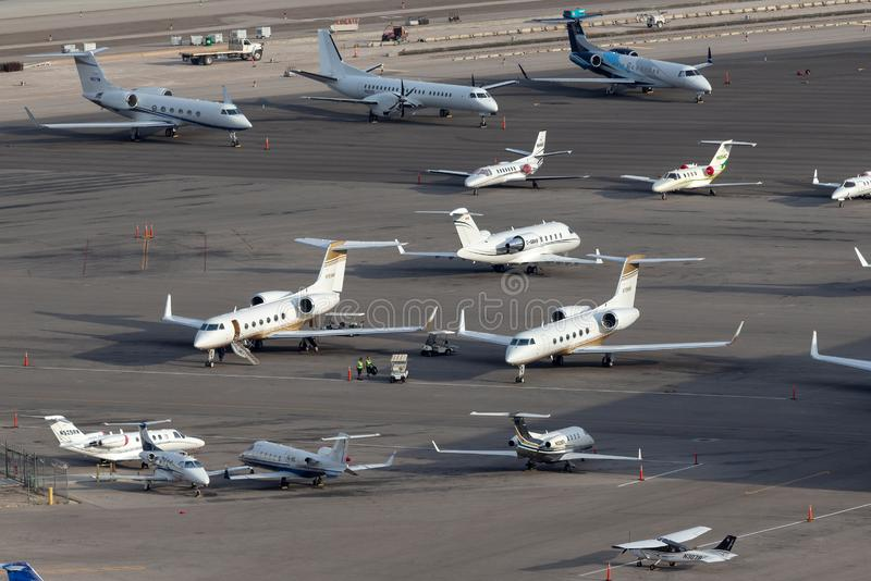 Overview of the private jet ramp at McCarran International Airport Las Vegas with multiple luxury jets parked on the tarmac stock images