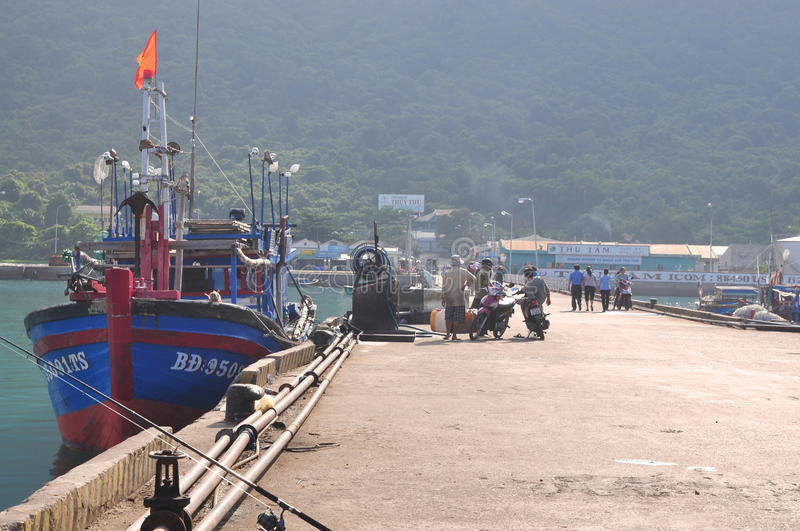 An overview at the seaport of Con Dao island with fisherman and fishing boats parking royalty free stock photography