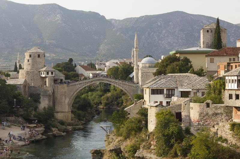Overview of Stari Most bridge at sunset, with bosnian hills in the background stock photos