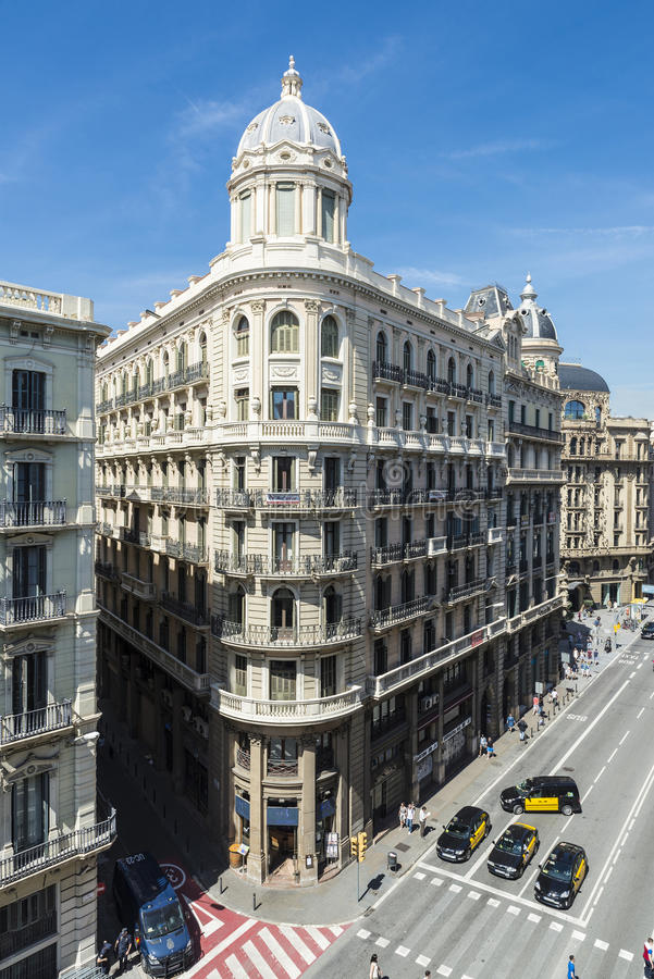 Overview of a street of Barcelona. Barcelona, Spain - May 2, 2015: Overview of a street called Via Laietana with people walking, waiting taxis and police on duty royalty free stock image