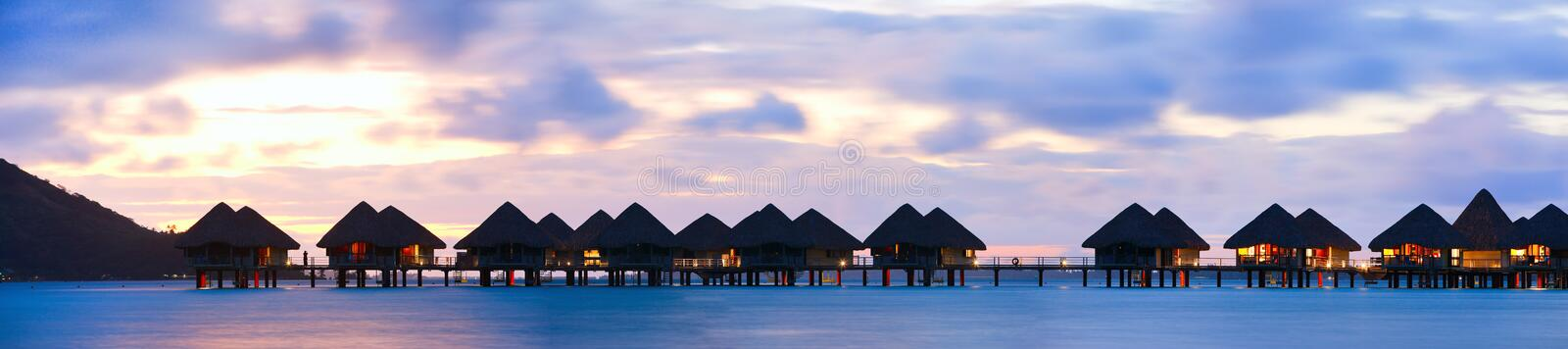 Overwater bungalows. Panorama of over the water bungalows at sunset stock image
