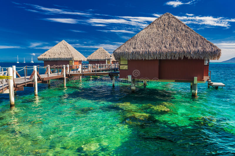Overwater bungalows with best beach for snorkeling, Tahiti, Poly. Overwater bungalows with best beach for snorkeling, Tahiti, French Polynesia royalty free stock image