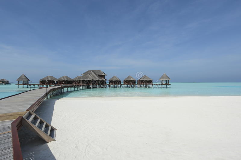 Overwater bungalows boardwalk inMaldives. Overwater bungalows boardwalk in Maldives resort royalty free stock images