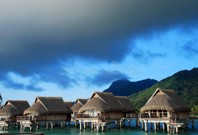 Overwater bungalows. Moorea, French Polynesia. Moorea is a high island in French Polynesia, part of the Society Islands, 17 km northwest of Tahiti stock photo