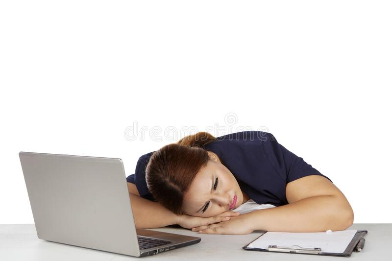 Overweight businesswoman sleeping during working stock photography