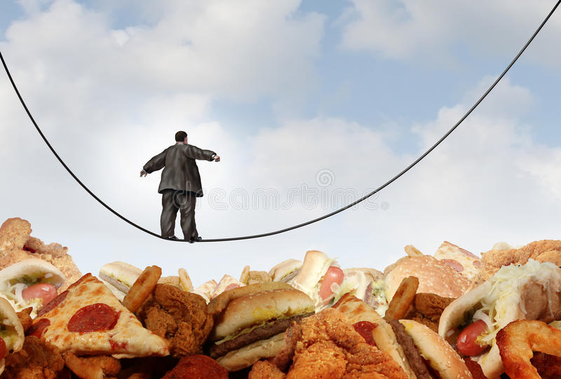 Overweight Diet Danger. Concept as an obese man walking on a tightrope high wire over mountains of greasy unhealthy junk food as a metaphor for dieting risk and