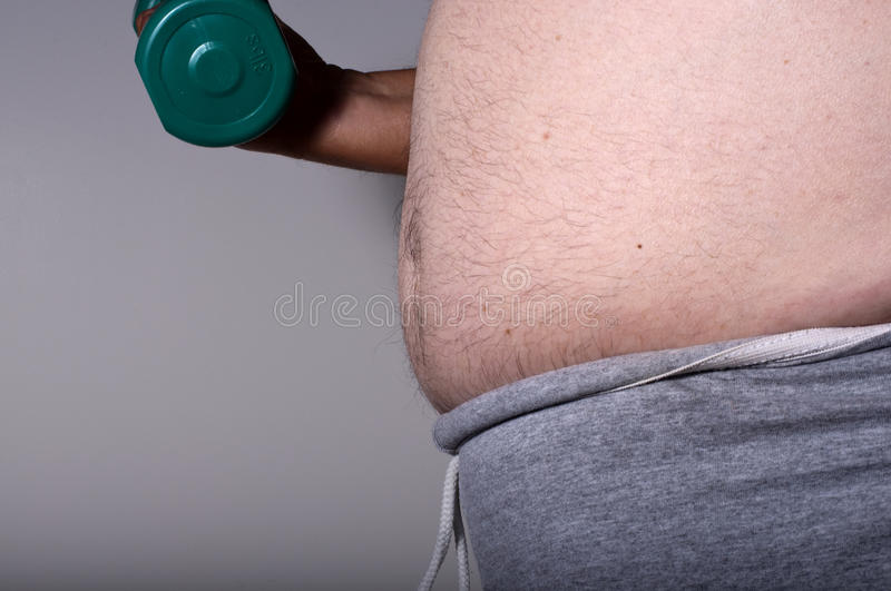Overweight Man With Dumbell Stock Photography