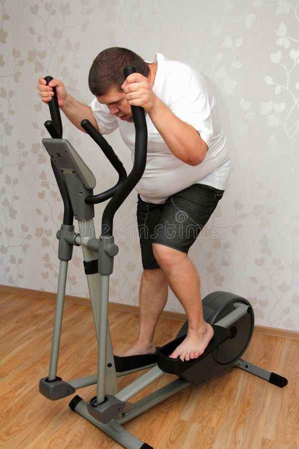 Download Overweight Man Exercising On Trainer Royalty Free Stock Photography - Image: 26739417