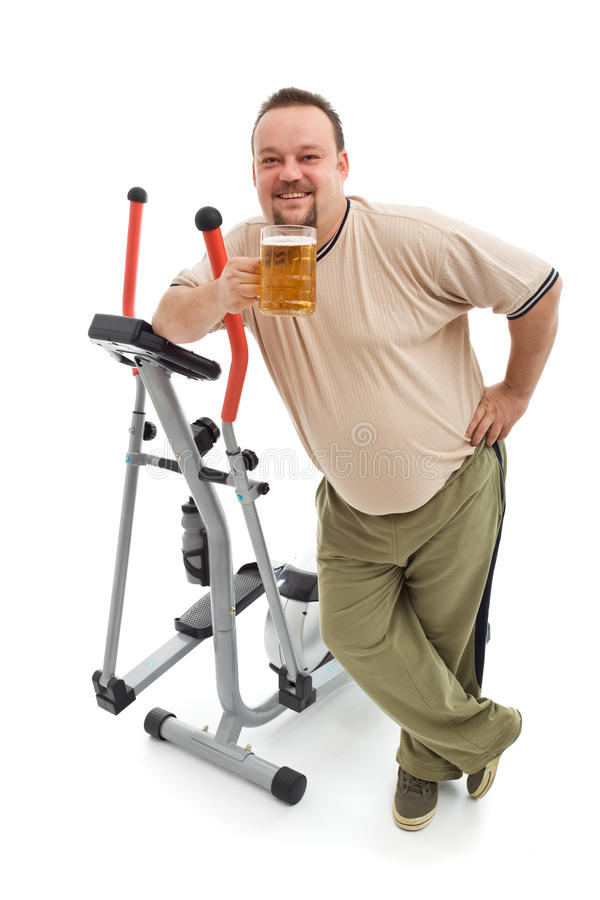Overweight Man Having A Beer After Working Out Royalty Free Stock Photography