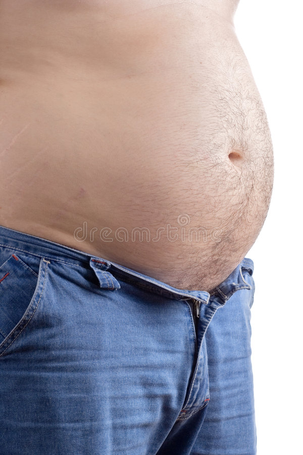 Overweight man with his pants half opened stock image