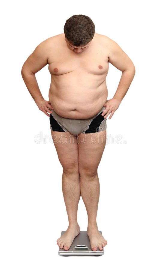 Overweight man on scales stock photos
