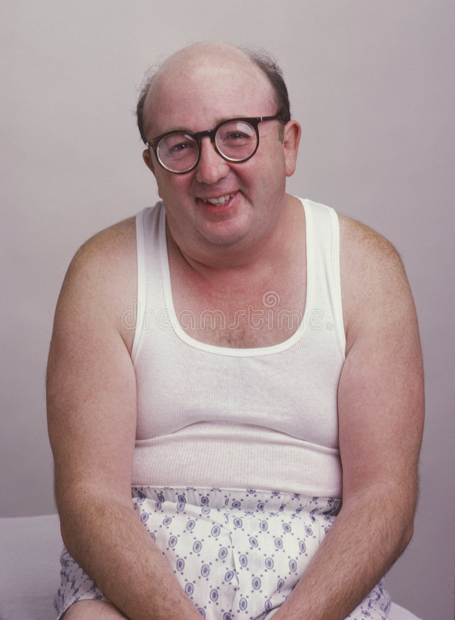 Overweight man in tank top. Smiling at camera royalty free stock images