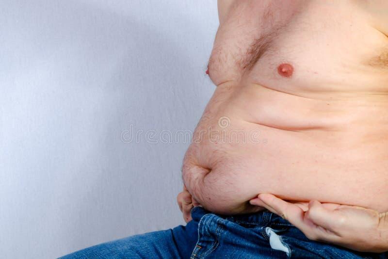 Shirtless overweight caucasian man stock photos