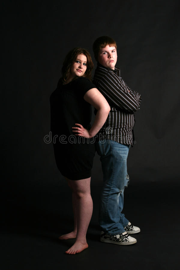 Free Overweight Teenage Couple Standing Back To Stock Image - 10070951