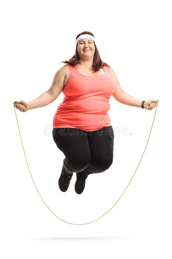 Overweight woman exercising with a skipping rope. Isolated on white background stock images