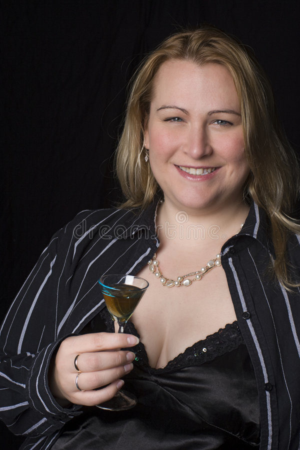 Overweight woman having a drink stock images