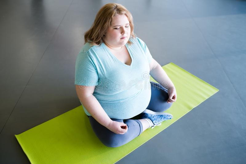 Overweight Woman Meditating stock photography