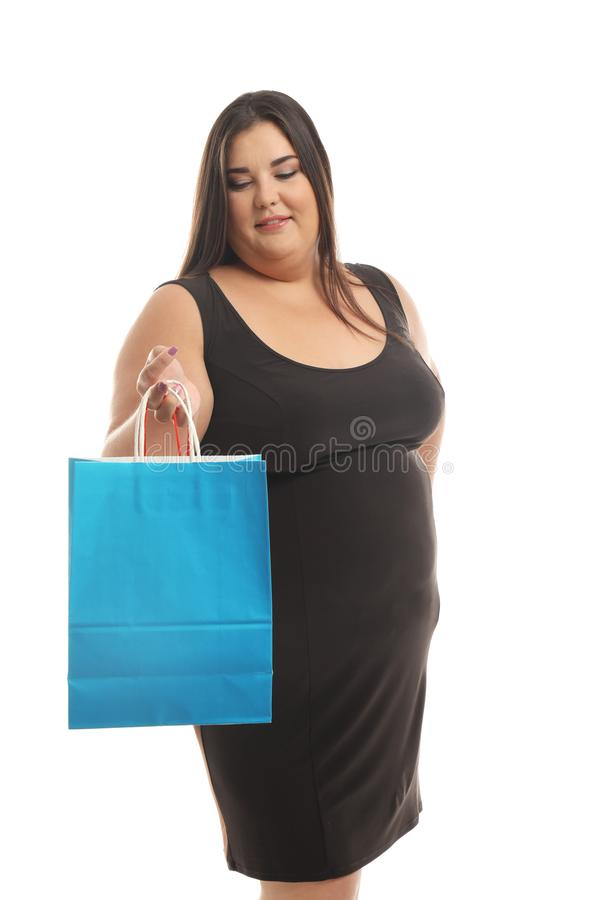 Overweight woman with shopping bag on white background royalty free stock photos