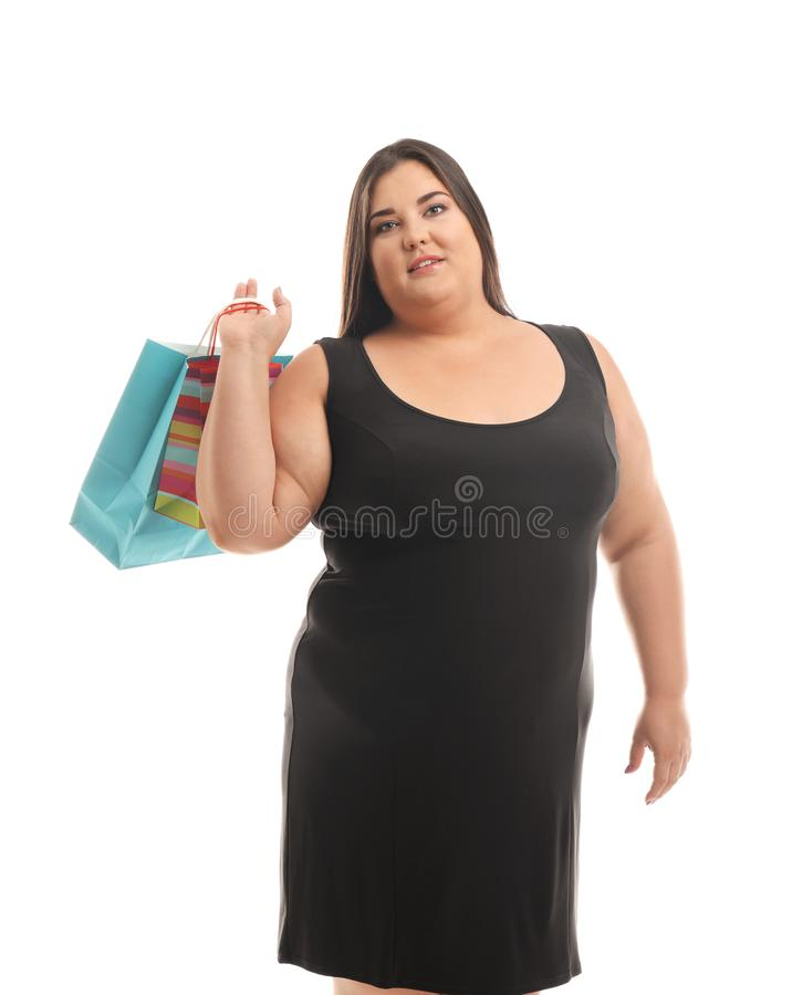 Overweight woman with shopping bags on white background stock photo