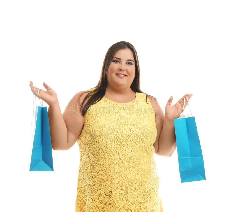 Overweight woman with shopping bags on white background stock photography