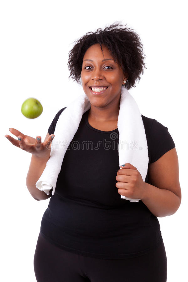 Free Overweight Young Black Woman Holding An Apple - African People Royalty Free Stock Photography - 31596567