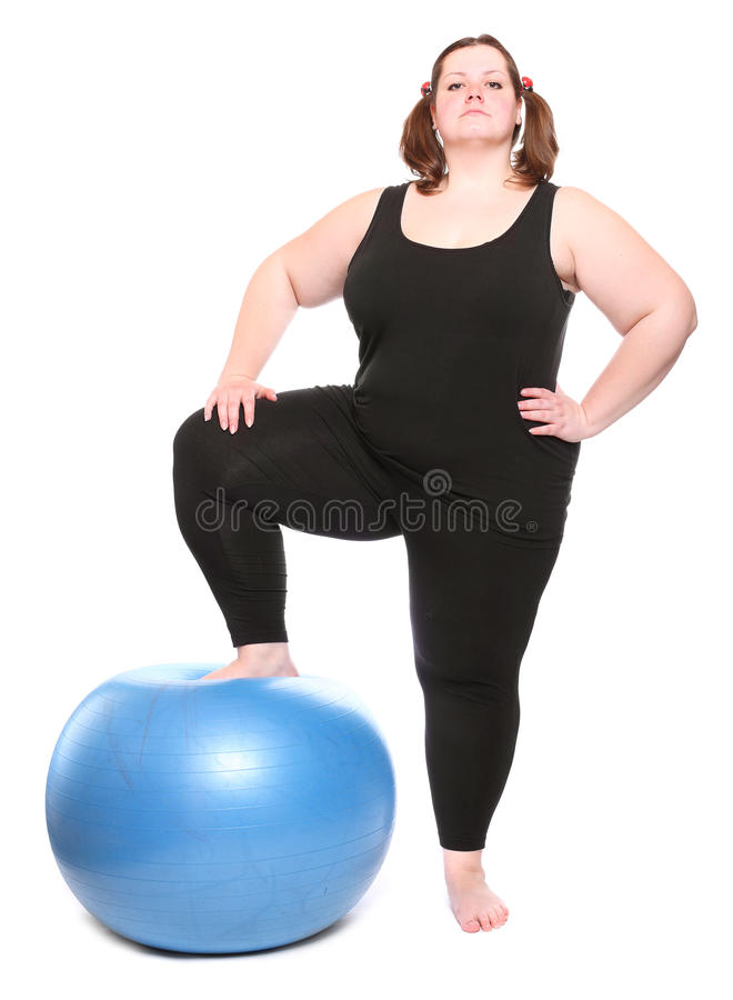 Overweight Young Woman With Blue Ball. Royalty Free Stock Photos