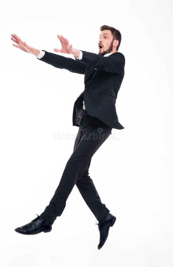 Overweldigde bange zakenman die met sterke wind vliegen die op hem blazen stock afbeeldingen